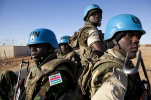 10 November 2011. El Fasher:  Gambian soldiers sitting at the back of a truck are escorting a visitor near UNAMID installations in El Fasher (North Darfur). 196 troops of the Gambian contingent are tasked with providing security at serveral UNAMID bases in El Fasher and escort to visitors.   Photo by Albert Gonzalez Farran - UNAMID